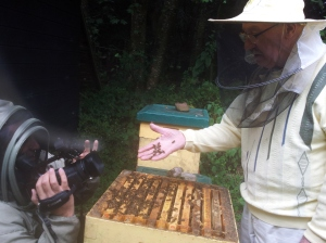 Andrew filming Micheál Mac with the bees